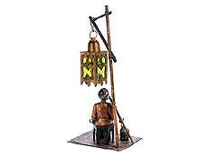 Detail images: Wiener Bronze eines Rauchers unter einer Lampe