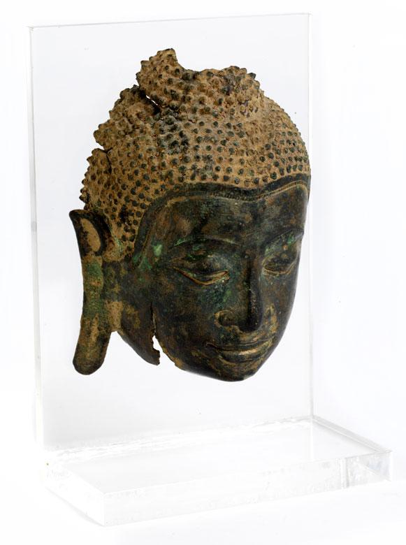Gesichtsfragment eines Buddha