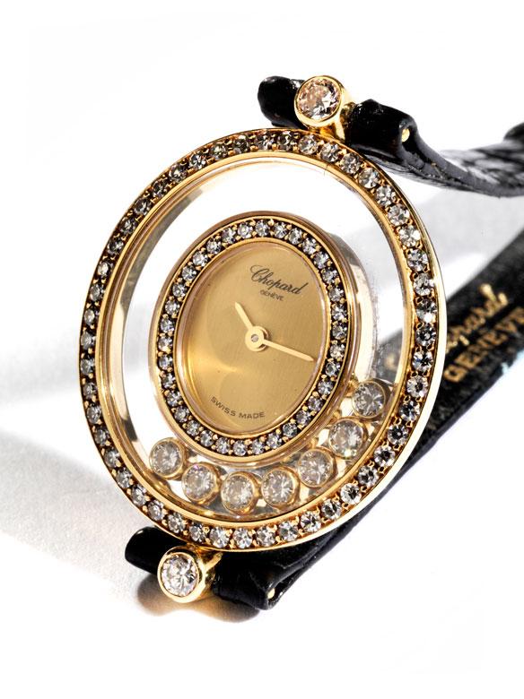 Damenarmbanduhr von CHOPARD Happy Diamonds in Gold