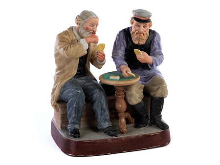 Russische Porzellanfigurengruppe eines bürgerlich gekleideten Russen