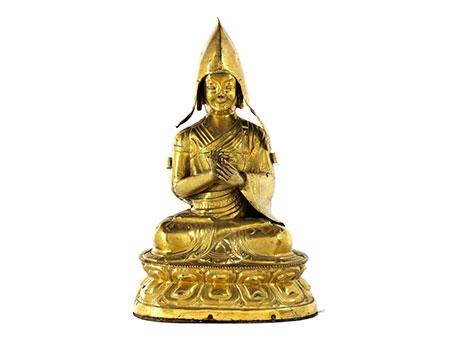 † Vergoldete Bronzefigur eines Lama im Lotussitz
