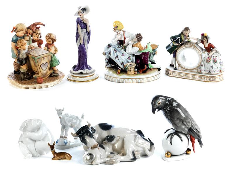 Konvolut von neun Porzellanfiguren und -figurengruppen
