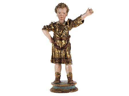 Seltene anmutige Schnitzfigur eines römisch gekleideten Knabens