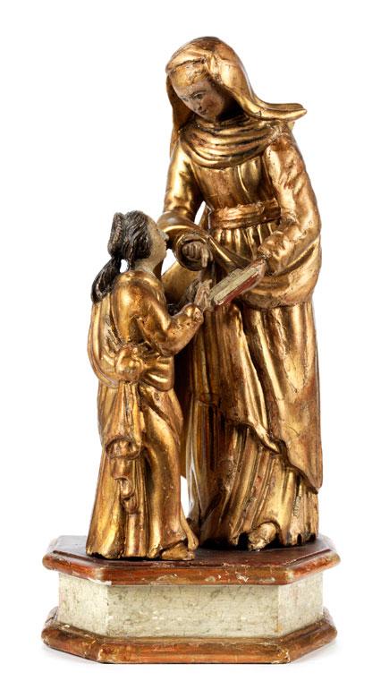 Schnitzfigurengruppe der Heiligen Anna bei der Lehrunterweisung der jugendlichen Maria