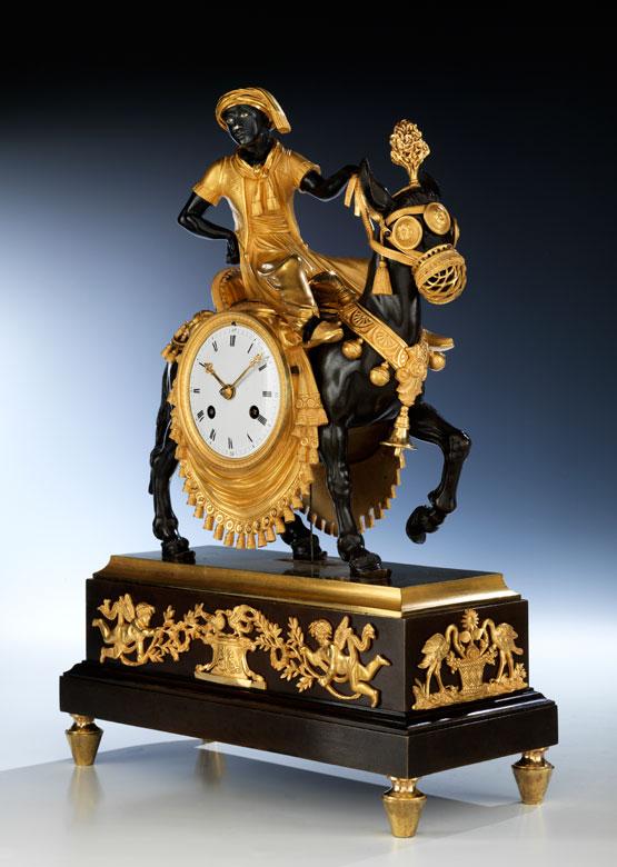 Französische Kaminuhr mit Figurengruppe Mohr auf einem Esel reitend