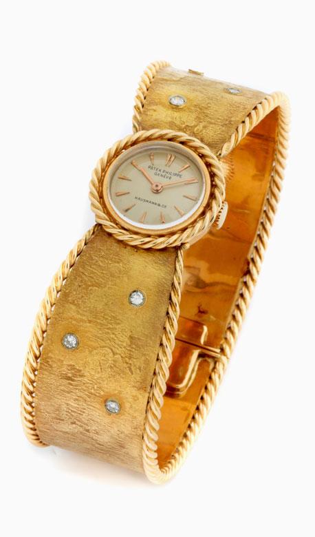 Damen PATEK PHILIPPE in Gold mit Goldspangenarmband