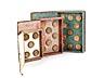 Details: Drei Bucheinbände mit innen montierten Gipsabdrücken von Spielsteinen