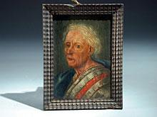 Gerahmtes Bildnis eines alten Mannes in Rüstung mit blauem Umhang