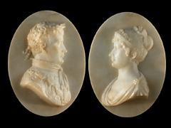 Paar Alabaster-Reliefporträts