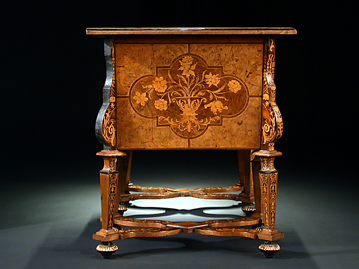 An opulent french th century louis xv style veneer inlaid and