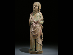 Schnitzfigur eines Apostels oder Heiligen im spätromanischen/frühgotischen Stil