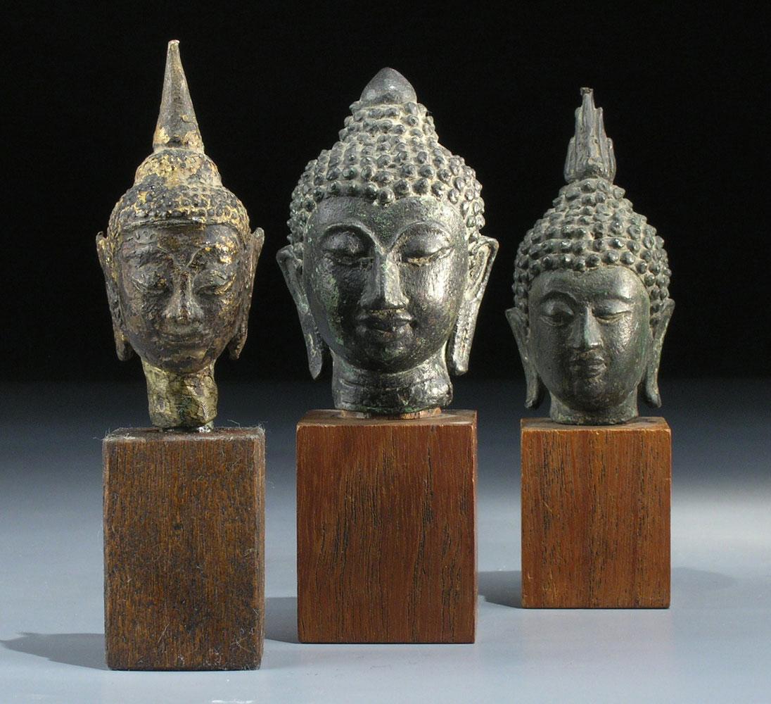 Drei Buddha-Köpfe