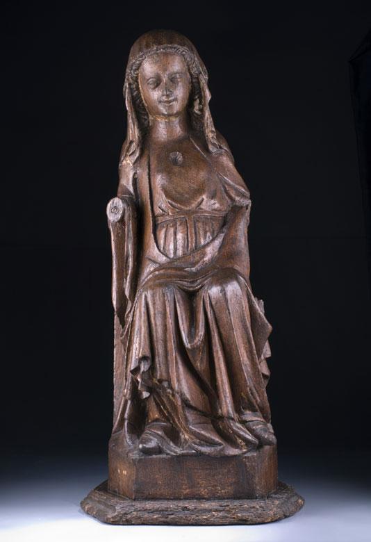 Schnitzfigur einer frühgotischen Madonna