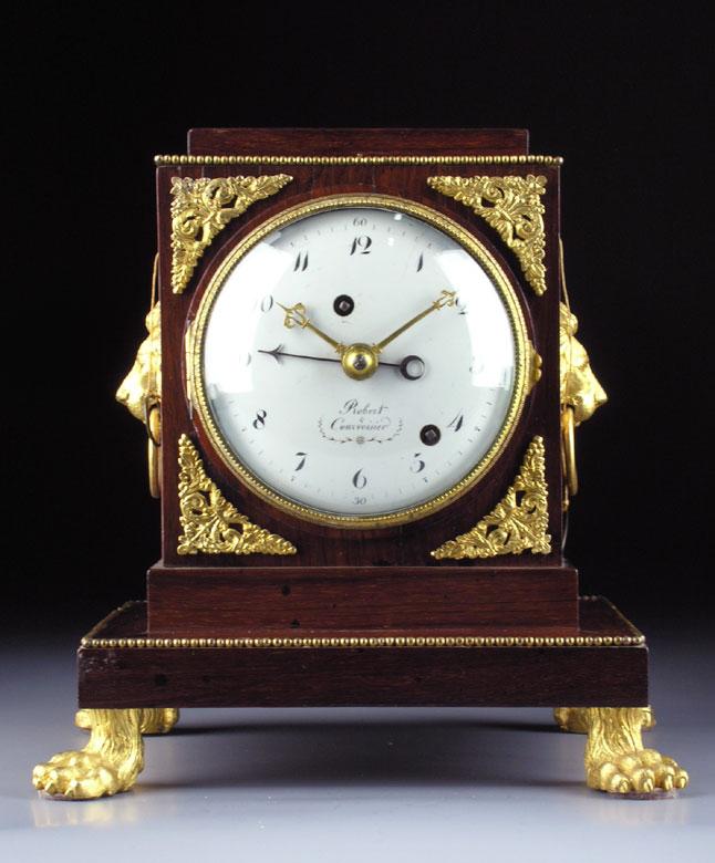 Tischuhr mit Palisandergehäuse und Werk von Robert & Courvoisier