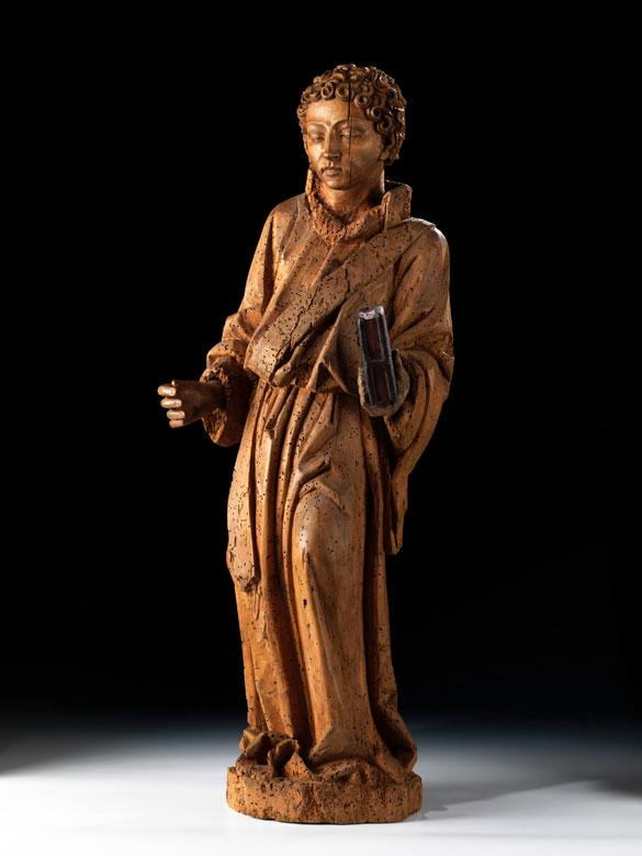 Schnitzfigur eines Heiligen mit Buch