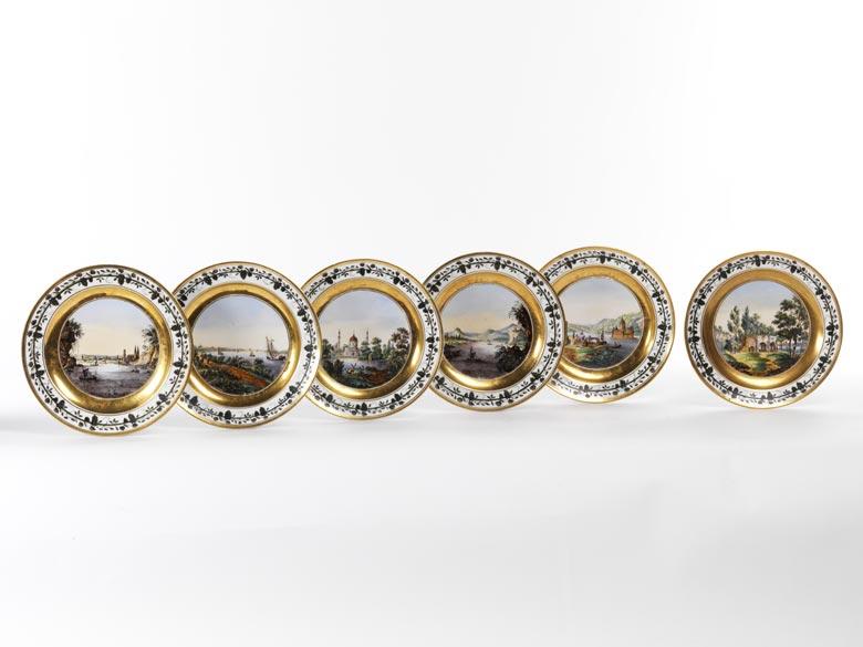 Satz von sechs Nymphenburger Porzellantellern mit Landschaftsmalereien
