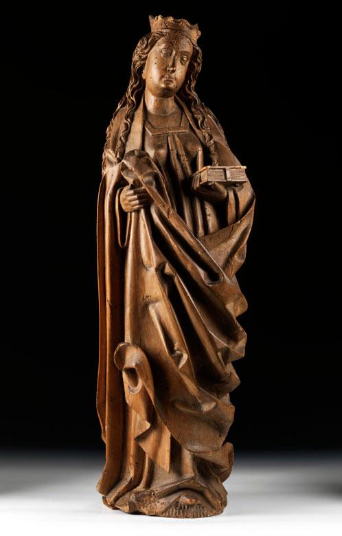 Spätgotische Schnitzfigur einer Heiligen mit Buch