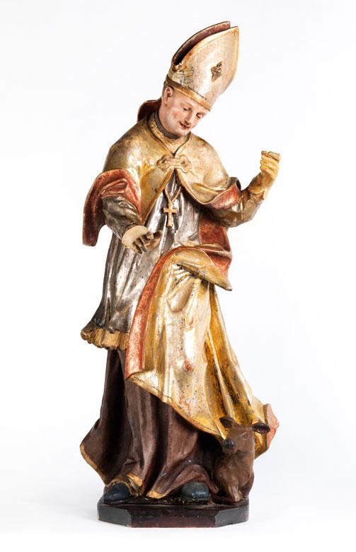 Schnitzfigur eines Heiligen mit Mitra, Chormantel und Kalb als Attribut
