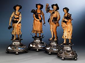 """Satz von vier Elfenbeinschnitzfiguren """"Die Vier Jahreszeiten auf Bergkristallsockeln mit Silbermontierung"""