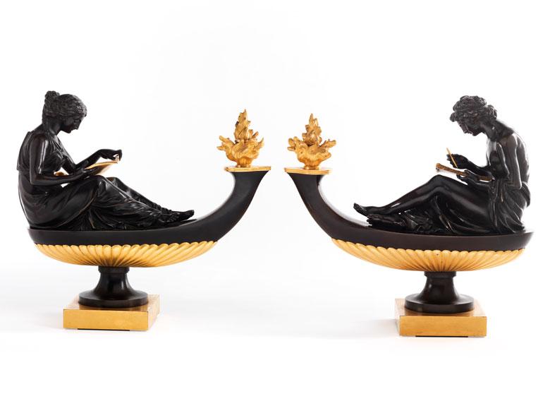 Paar seltene, figürlich in Bronze gegossene und feuervergoldete Öllampen