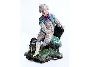 Porzellanfigurine eines Rokoko-Knaben auf Rasensockel
