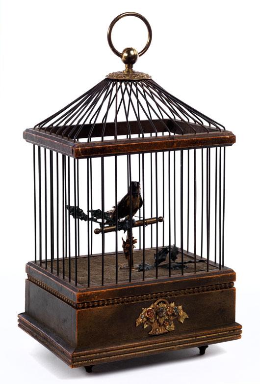 Singvogel-Automat in Form eines kleinen Vogelkäfigs