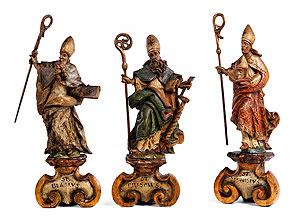 Drei Schnitzfiguren der Heiligen Blasius, Erasmus und Dionysios