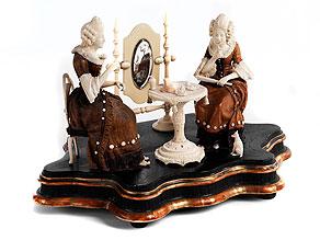 Figurengruppe in Elfenbein und Holz