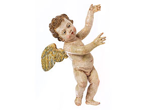 Kleine Schnitzfigur eines geflügelten Putto